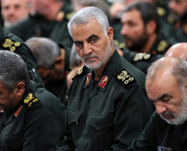 FILE - In this Sept. 18, 2016 file photo released by an official website of the office of the Iranian supreme leader, Revolutionary Guard Gen. Qassem Soleimani, center, attends a meeting with Supreme Leader Ayatollah Ali Khamenei and Revolutionary Guard commanders in Tehran, Iran. Iran's Revolutionary Guard is warning Islamic State militants that missile attacks launched into eastern Syria the previous day can be repeated if the extremists take action against Iran's security. (Office of the Iranian Supreme Leader via AP)