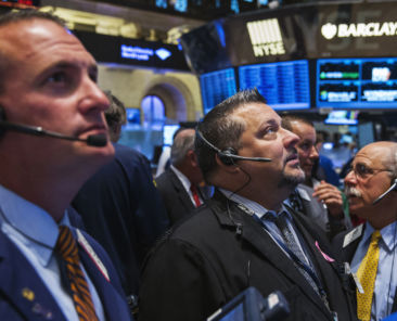 Traders work on the floor of the New York Stock Exchange shortly after the market's opening in New York July 28, 2014. REUTERS/Lucas Jackson (UNITED STATES - Tags: BUSINESS) - RTR40EIE