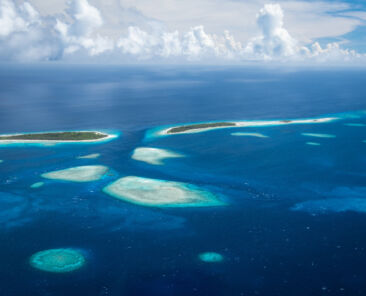 Aerial view of some of the islands an islets of Kwajalein Atoll, Marshall Islands. One of the first groups of islands that will disappear due to sea level rise because of climate change. Ebeye Island is one of the most populated pieces of land on Earth. The US Army Garrison Kwajalein Atoll is in this atoll.