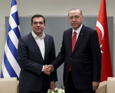 Turkey's President Recep Tayyip Erdogan, right, shakes hands with Greece's Prime Minister Alexis Tsipras, left, prior to their talks in New York, Tuesday, Sept. 25, 2018. The two leaders are in New York for the 73rd session of the United Nations General Assembly. (Presidential Press Service via AP, Pool)