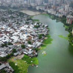 Aerial view of the slum of Koreil and surrounding neighborhoods of Dhaka. Dhaka is chocked by its 16 min residents. 400,000 people migrate from farmlands to Dhaka every year 70% of them quote environmental shock as a main reason for migration. These families usually end up in the poorest, most flood-prone areas of the city where they live in a constant fear of another flood. Photo by Frank Sedlar