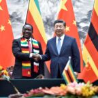 Chinese President Xi Jinping shakes hands with Zimbabwean President Emmerson Mnangagwa as they pose for the media after a signing ceremony at the Great Hall of the People in Beijing, China April 3, 2018. Parker Song/Pool via REUTERS
