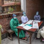 Health workers wearing protective gear wait for patients at a health centre during a government-imposed lockdown as a preventive measure against the COVID-19 coronavirus, in Kathmandu on April 22, 2020. (Photo by PRAKASH MATHEMA / AFP)