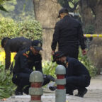 "National Security Guard soldiers inspect the site of a blast near the Israeli Embassy in New Delhi, India, Saturday, Jan. 30, 2021. A ""very low intensity"" device exploded Friday near the Israeli Embassy in the Indian capital, but there were no injuries and little damage, police said. (AP Photo/Dinesh Joshi)"